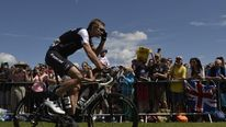 Germany's Jens Voigt rides at the departure village in Cambridge prior to the start of the 155 km third stage of the 101st edition of the Tour de France cycling race