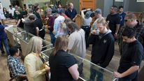 Customers shop for marijuana at Top Shelf Cannabis, a retail marijuana store, on July 8, 2014 in Bellingham, Washington.