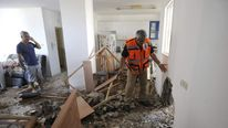 Damage to a house after a rocket fired by Palestinian militants hit a home in Ashkelon in Gaza
