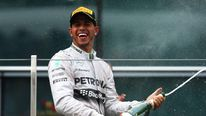 Lewis Hamilton of Great Britain and Mercedes GP celebrates his victory following the Chinese Formula One Grand Prix