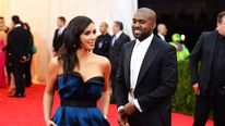 Kim Kardashian (L) and Kanye West