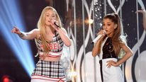 Recording artists Iggy Azalea (L) and Ariana Grande perform onstage during the 2014 Billboard Music Awards.