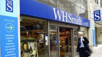 A pedestrian walks past the book seller WH Smith