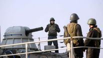 Ukrainian sailors man the naval ship Slavutych in Sevastopol bay