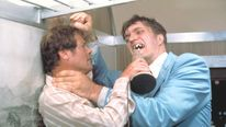 "Richard Kiel, right, as Jaws and Roger Moore, as James Bond, fighting in the 1977 film, ""The Spy Who Loved Me."""