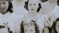 A copy of a school photo of Marilyn Monroe (centre), known then as Norma Jean Dougherty.