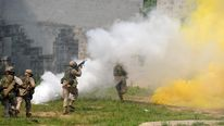 US Marines use smoke grenade as they att