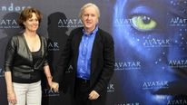 US actress Sigourney Weaver (L) poses with James Cameron