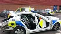 Driver held after police car crash