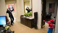 President Obama gets caught in Spiderman's web. Photo credit Pete Souza/ The White House