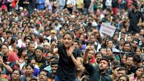 A demonstrator shouts slogans during a protest in the southern Indian city of Bangalore