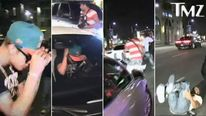 TMZ video grabs show Justin Bieber appearing to hit a photographer, who was standing in the road, with his white Ferrari