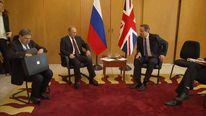 Vladimir Putin and David Cameron.
