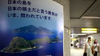 A poster of the disputed islands known as Senkaku in Japan and Diaoyu in China displayed in Tokyo's underground