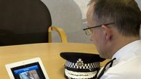 Assistant Commissioner Mark Rowley uses the Facewatch App