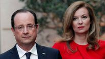 French President Hollande and his companion Valerie Trierweiler arrive for a state dinner at the Elysee Palace in Paris
