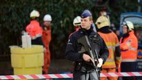 Policemen and firemen set a security cordon around Brussels' Great Mosque in Brussels on November 26.