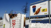A poster of an Ikea in Sweden with a hot dog on display