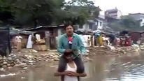 Narayan Pargaien perching on the villager's shoulders