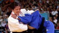 Japan's Haruka Tachimoto fights with Cuba's Onix Cortes Aldama at the London 2012 Olympic Games