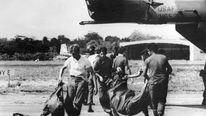 US military remove bags containing bodies of members of the Jim Jones' sect