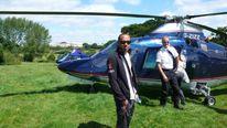 Pilot Pete Barnes with F1 driver Lewis Hamilton. Photo courtesy of RotorMotion