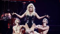 Singer Ke$ha performs with dancers during the iHeartRadio Music Festival in Las Vegas