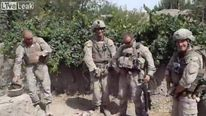 US Marines pictured apparently urinating on dead Taliban fighters