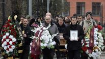 Friends and relatives take part in the funeral ceremony of Sergei Magnitsky