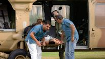 A man wounded by rocket fire is carried out of a helicopter by hospital workers upon arrival at Soroka hospital in the southern Israeli city of Beersheba.