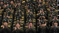 North Koreans celebrate their military might after the successful rocket launch