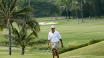 US President Barack Obama plays golf in Hawaii