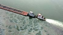 US Coast Guard photo shows barge loaded with marine fuel oil partially submerged in the Houston Ship Channel