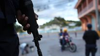 Police patrol the streets of a gang ridden neighbourhood in Tegucigalpa
