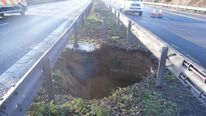 15-metre deep pothole in central reservation closes M2 - Highways Agency