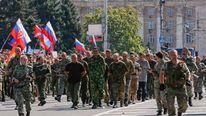 Pro-Russian separatists parade Ukrainian prisoners through Donetsk