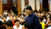 A relative of five passengers who were on board Malaysia Airlines flight MH370 cries as she speaks at the meeting