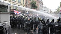 Water cannon is used to disperse protesters during rioting in Belfast
