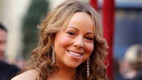 Singer Mariah Carey arrives at the 82nd Academy Awards