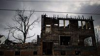 A burnt out abandoned apartment building is seen in Detroit