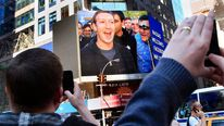 Mark Zuckerberg is seen on a screen televised