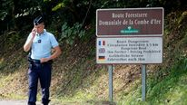 French gendarmes block the access road to La Combe d'Ire in Chevaline near Annecy, southeastern France