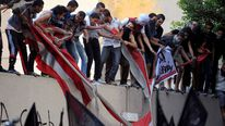 Protesters destroy American flag pulled down from US embassy in Cairo, Egypt