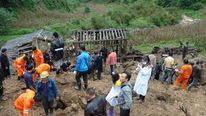 Rescuers Search For Victims Of Primary School Landslide