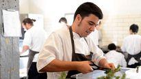 Chefs prepare dishes in Noma restaurant, Copenhagen