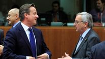 David Cameron talks with Jean-Claude Juncker