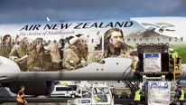An Air New Zealand's Boeing 777-300ER featuring livery advertising the film The Hobbit: An Unexpected Journey is loaded after landing at Heathrow Airport in London