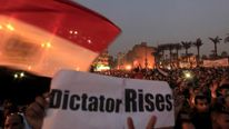 Anti-Mursi protesters chant anti-government slogans in Tahrir Square in Cairo