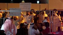 Protesters hold banners as they demonstrate outside a newly built shopping mall during a promotional visit by U.S. television celebrity Kim Kardashian, in Riffa, south of Manama