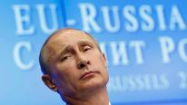 Russian President Putin looks on during a news conference following EU-Russia summit in Brussels
